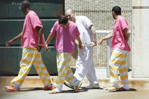 hot pink and yellow and white stripe jail uniforms