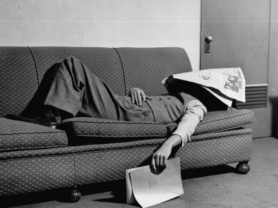 dorsey-paul-writer-niven-busch-lying-on-sofa-with-newspaper-over-his-face-as-he-takes-nap-from-screenwriting
