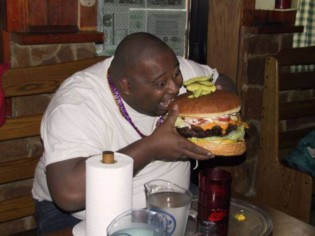 weird-people-fat-guy-eating-huge-hamburger