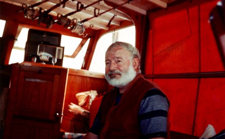 Hemingway aboard his boat off the coast of Cuba (1950)